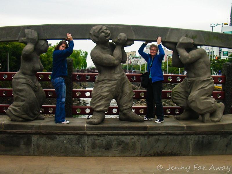 Mom and I holding up a bridge on Jeju Island, South Korea.