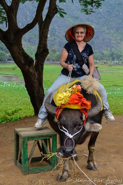 My Mom sitting on a water buffalo!