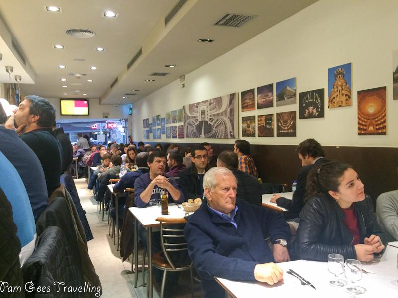 In a crowded Café Santiago F