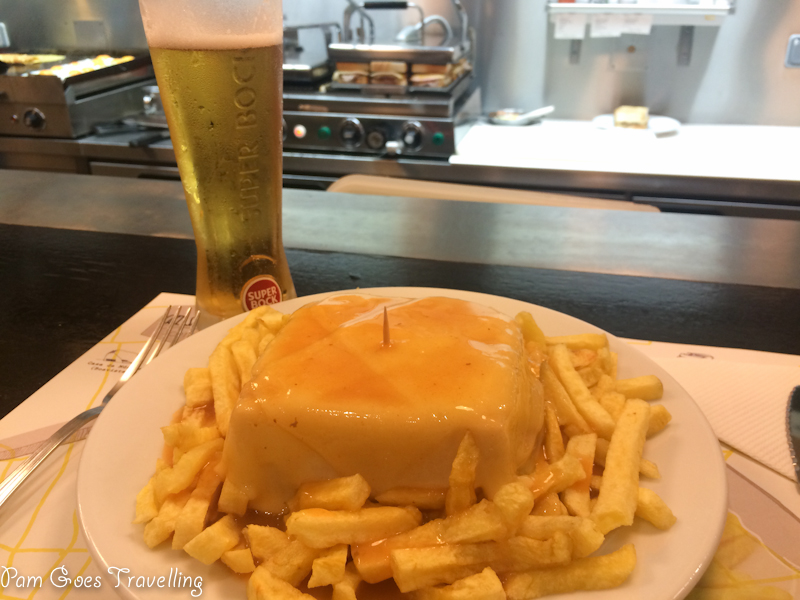 Having a francesinha in Porto